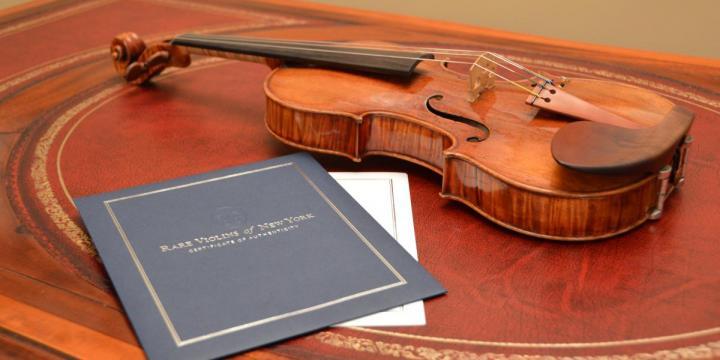 violin and paperwork